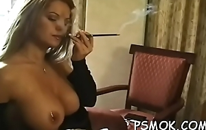 Girl enjoys a cigarette while putting a restaurant check regarding her throat