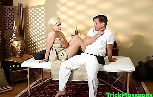 Busty bush-leaguer gagging on cock during massage