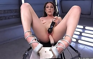 Brunette rides machine coupled with Sybian