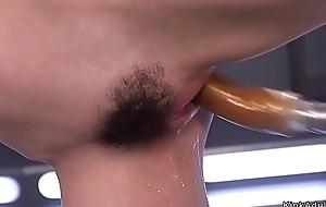 Hairy twat brunette copulates machine