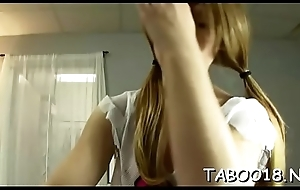 Pleasant ill-lighted babe gives a spicy footjob nigh casual dude