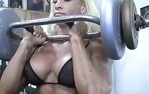 Bazaar Female Bodybuilder in See Thru Summit Works Out Hard