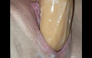 Creamy pussy pulling huge dildo