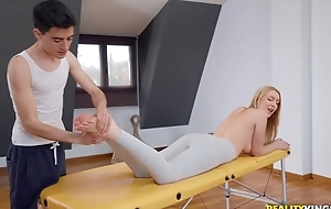 Fit blondie receives oiled up and fucked away from her masseur