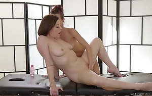 Two insatiable lesbos trample passionately during a rub-down