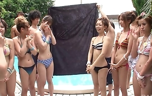 Group of bonny Oriental angels having fun by the pool